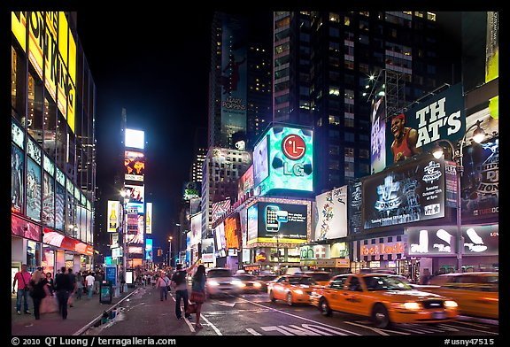 Yellow taxicabs, Times Squares at night. NYC, New York, USA (color)