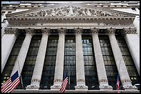 Looking up New York Stock Exchange with flags at half-mast. NYC, New York, USA ( color)