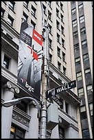 Street signs at the intersection of Wall Street and Nassau Street. NYC, New York, USA ( color)