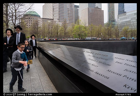 Jewish family walks by 9/11 Memorial. NYC, New York, USA (color)