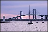 Newport Bridge and Newport Harbor lighthouse at sunset. Newport, Rhode Island, USA