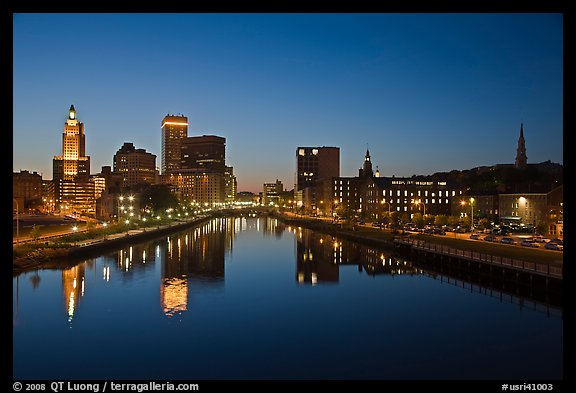 Wide view of downtown buildings reflected in Seekonk river at dusk. Providence, Rhode Island, USA (color)