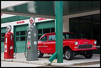 Vintage gas pumps and car, Deadwood. Black Hills, South Dakota, USA (color)