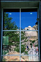Cliff and sculptures reflected in a window, Mount Rushmore National Memorial. South Dakota, USA