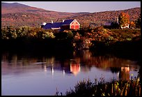 Red barns reflected in Line Pond near Pomfret. Vermont, New England, USA (color)