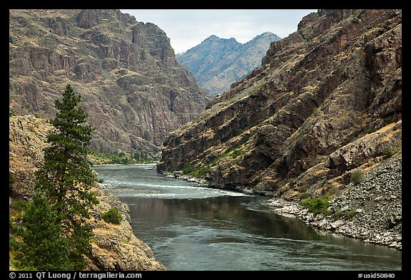 High cliffs above free-flowing part of Snake River. Hells Canyon National Recreation Area, Idaho and Oregon, USA (color)