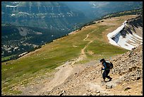 Hiker descending Table Mountain Trail. Jedediah Smith Wilderness,  Caribou-Targhee National Forest, Idaho, USA ( color)