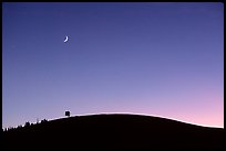 Curve of cinder cone, pastel sky, and moon, Craters of the Moon National Monument. Idaho, USA (color)