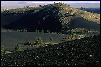 Slopes covered with hardened lava and cinder, Craters of the Moon National Monument. Idaho, USA ( color)