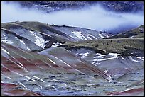 Painted hills with snow and fog. John Day Fossils Bed National Monument, Oregon, USA