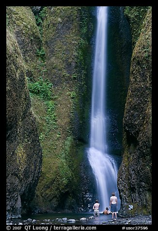 Men soaking at the base of Oneonta Falls. Columbia River Gorge, Oregon, USA (color)
