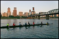 Eight-oar shell on Williamette River and city skyline. Portland, Oregon, USA