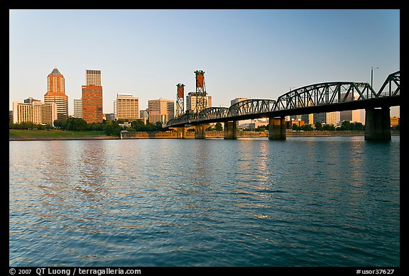 Portland skyline, Hawthorne Bridge, and Williamette River at sunrise. Portland, Oregon, USA (color)