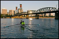 Men on double-oar shell rowing on Williamette River. Portland, Oregon, USA (color)