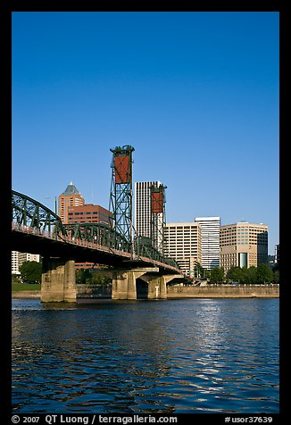 Williamette River at Hawthorne Bridge and high-rise buildings. Portland, Oregon, USA (color)