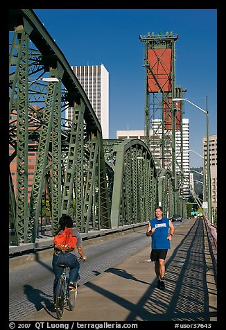 Jogger and cyclist on Hawthorne Bridge. Portland, Oregon, USA