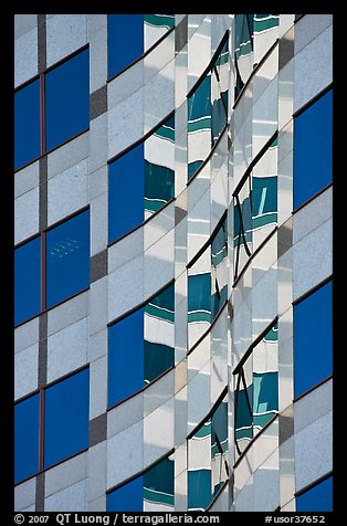 Pattern of windows and reflections in high rise building. Portland, Oregon, USA (color)