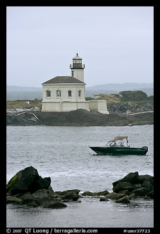 Small boat and Coquille River lighthouse. Bandon, Oregon, USA (color)