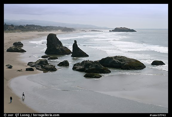 Beach at Face Rock with two people walking. Bandon, Oregon, USA (color)