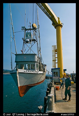 Fishing boat hoisted from water, Port Orford. Oregon, USA