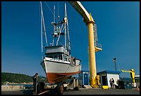 Fishing boat lifted onto deck, Port Orford. Oregon, USA