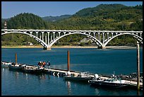 Small boat deck and Rogue River bridge. Oregon, USA