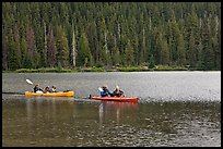 Parents kayaking with children in tow, Devils Lake. Oregon, USA ( color)