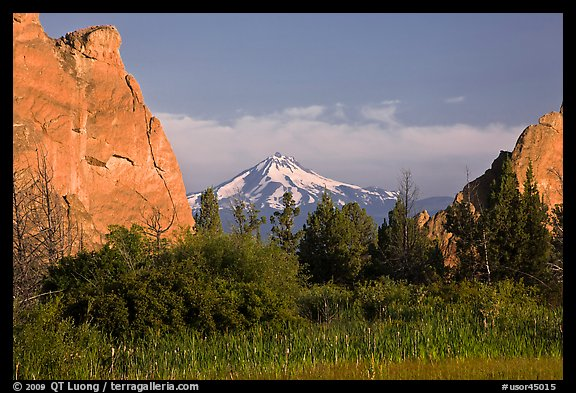 Snow-capped volcano seen between rock pinnacles. Smith Rock State Park, Oregon, USA (color)