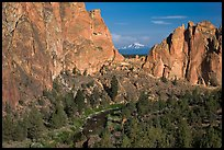 Oregon cascades seen through cliffs. Smith Rock State Park, Oregon, USA