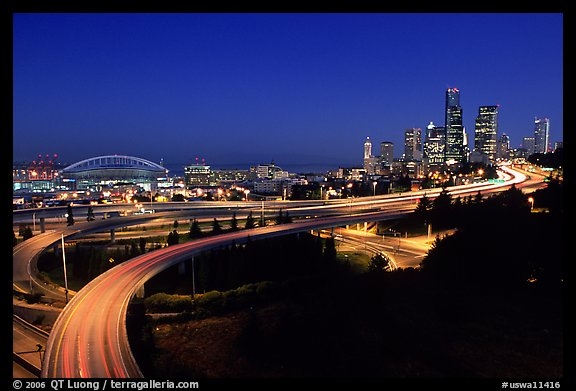 Seattle skyline, Qwest Field and freeways at dawn. Seattle, Washington (color)