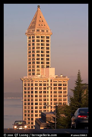 Smith Tower and cars on steep street, early morning. Seattle, Washington (color)