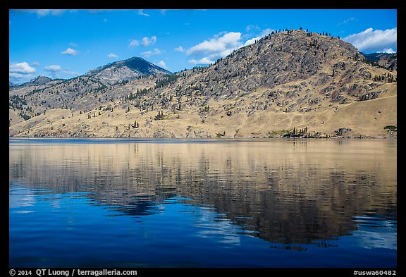 Dry hills reflected in Lake Chelan. Washington (color)
