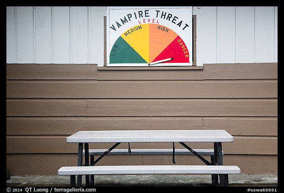 Bench and vampire threat sign near Forks. Olympic Peninsula, Washington (color)