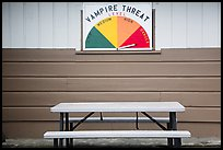 Bench and vampire threat sign near Forks. Olympic Peninsula, Washington ( color)
