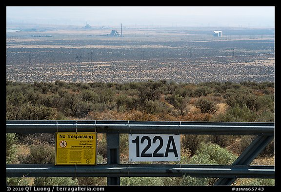 Fence and distant nuclear reactors, Hanford Reach. Washington (color)