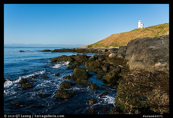 Rocky coastline and Cattle Point Lighthouse, San Juan Islands National Monument, San Juan Island. Washington (color)