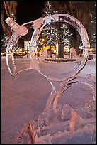 Town square statue framed by ice sculpture. Jackson, Wyoming, USA (color)