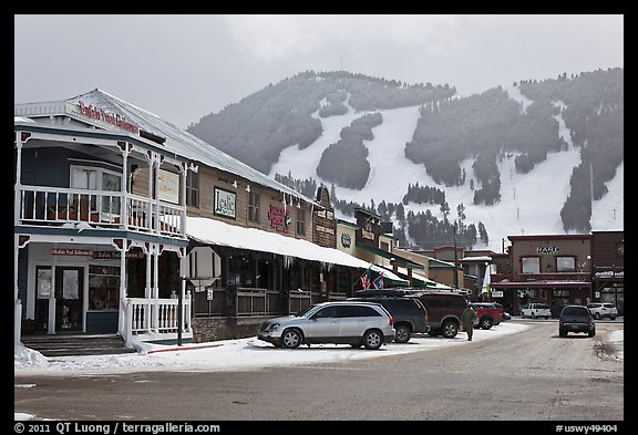 Town square stores and ski slopes in winter. Jackson, Wyoming, USA (color)