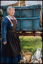 Woman with Pionneer wagon. Fort Laramie National Historical Site, Wyoming, USA ( color)
