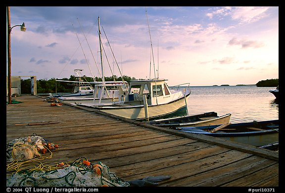 Pier and small boats at sunset, La Parguera. Puerto Rico