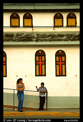 Woman and boy talking besides a church, La Parguera. Puerto Rico (color)