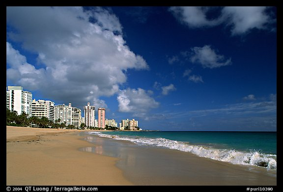 Beach and modern residential towers, morning. San Juan, Puerto Rico (color)