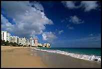 Beach and modern residential towers, morning. San Juan, Puerto Rico ( color)