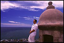 Man leaning against a lookout turret, Fort San Felipe del Morro. San Juan, Puerto Rico (color)