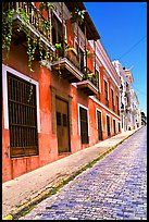 Old cobblestone street and pastel-colored houses, old town. San Juan, Puerto Rico