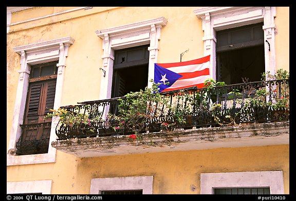 Balcony and flag of Puerto Rico. San Juan, Puerto Rico (color)
