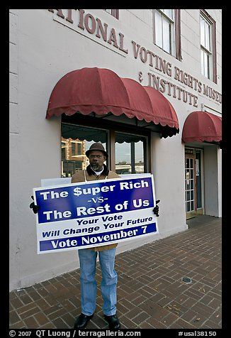 African-American man holding a voting sign in front of the voting rights museum. Selma, Alabama, USA (color)