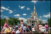 Girls on fathers shoulders, Cinderella Castle. Orlando, Florida, USA (color)