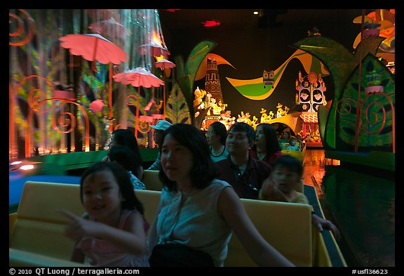 Families in indoor boat ride, Magic Kingdom. Orlando, Florida, USA (color)