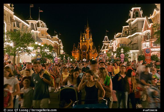 Main Street at night with crowds and castle. Orlando, Florida, USA (color)